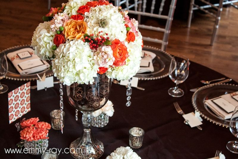 Orange peach and ivory arrangements