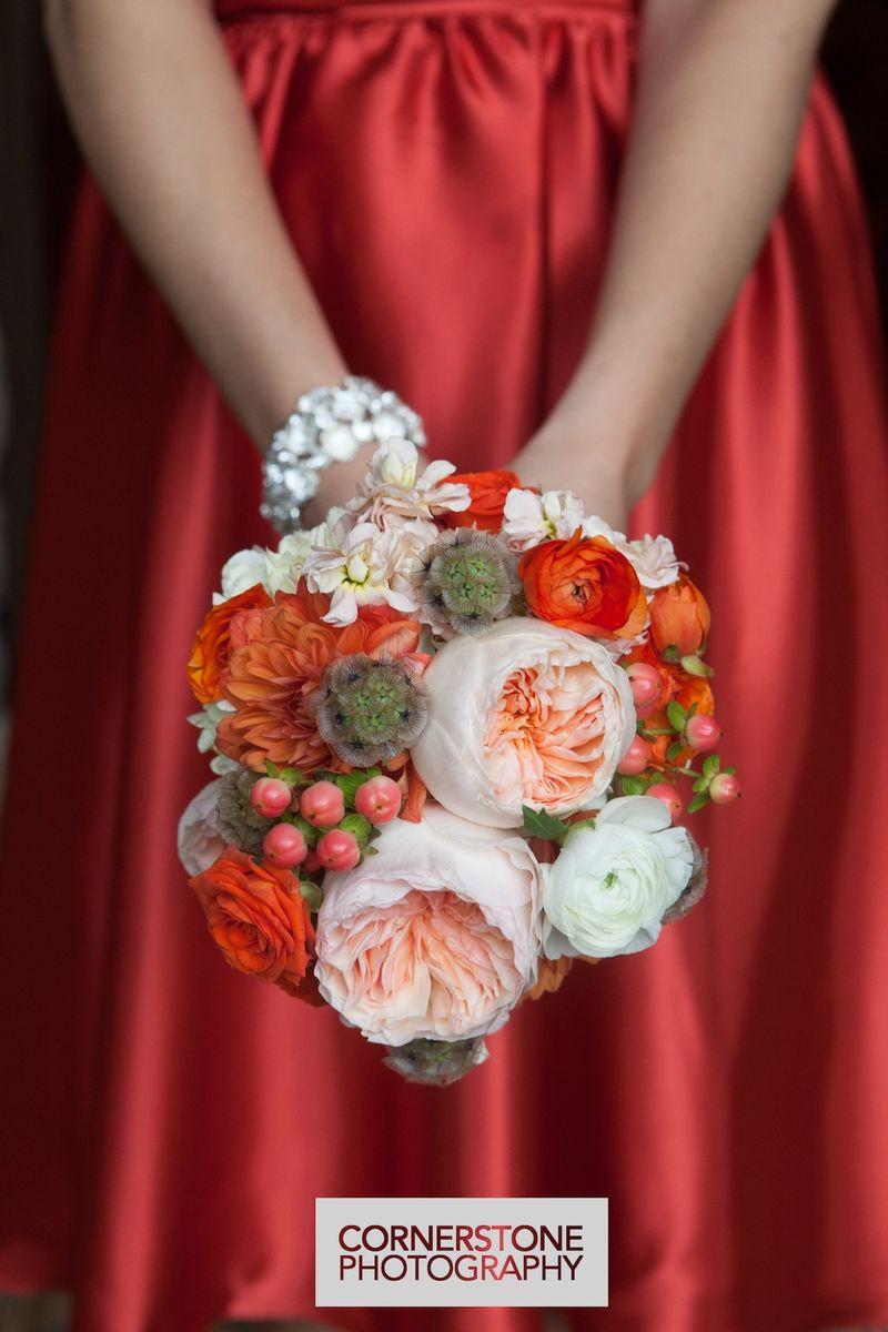 Peach garden roses and orange dahlias