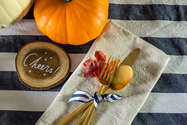gold flatware, and navy and white striped table runners