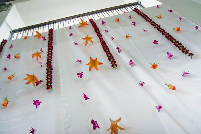 Strung floral ceremony backdrop