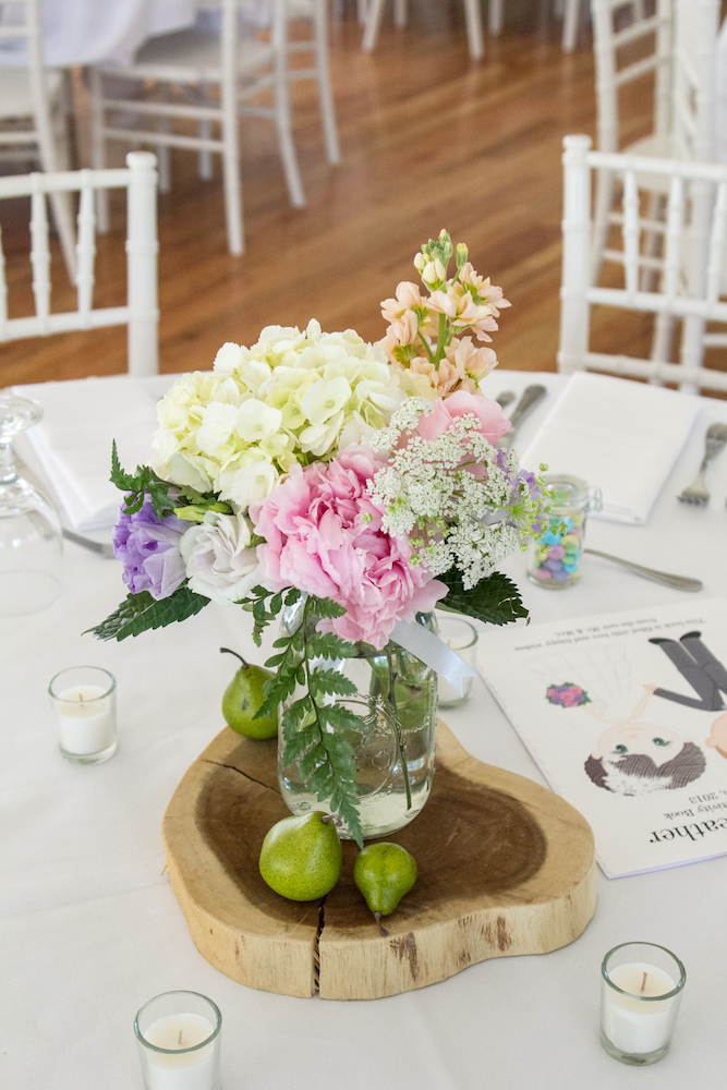 Mason jar and wood slice centerpieces