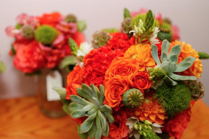 Orange bouquet with succulents.