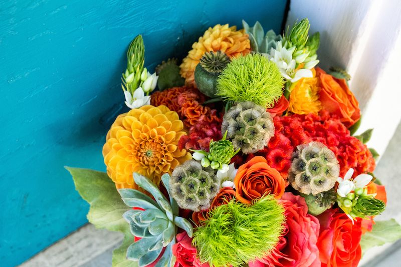 Orange roses and dahlias