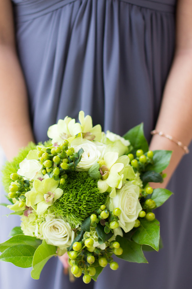 Green bouquet with berries, orchids, and roses