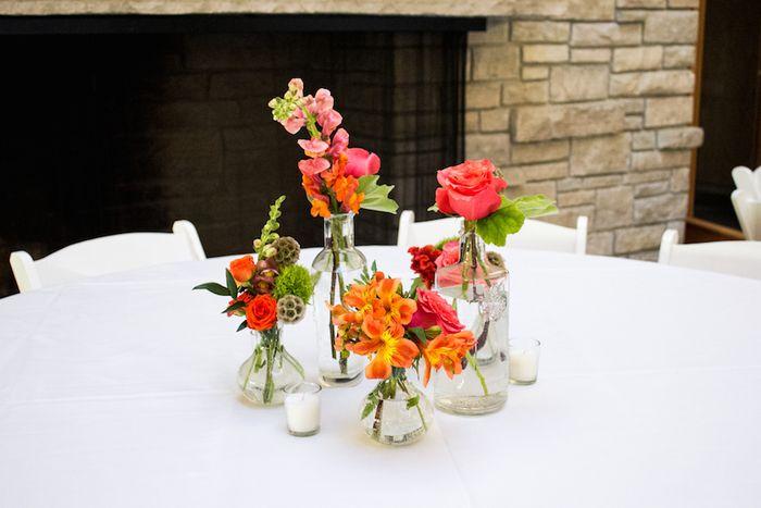 Bud vase centerpieces with orange flowers
