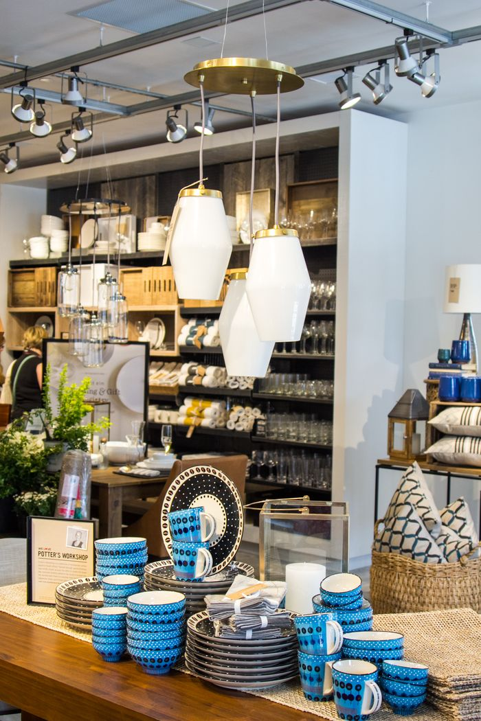 White and gold light fixture at West Elm