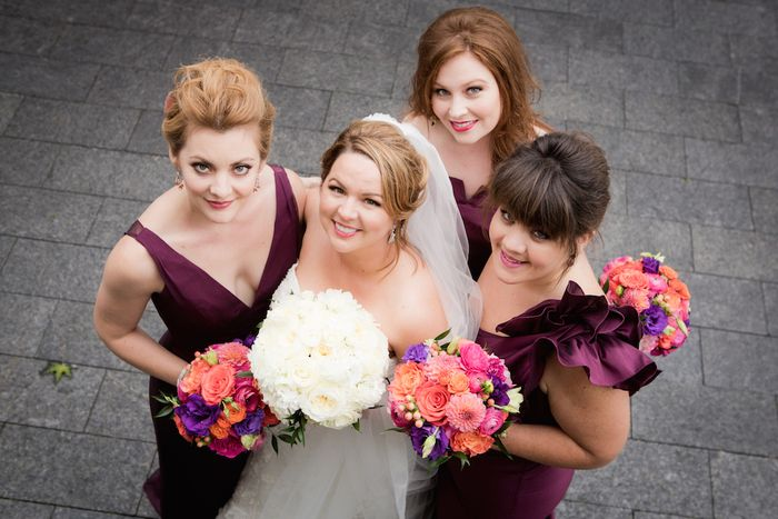 Coral-pink-and-plum-bridesmaids-bouquets