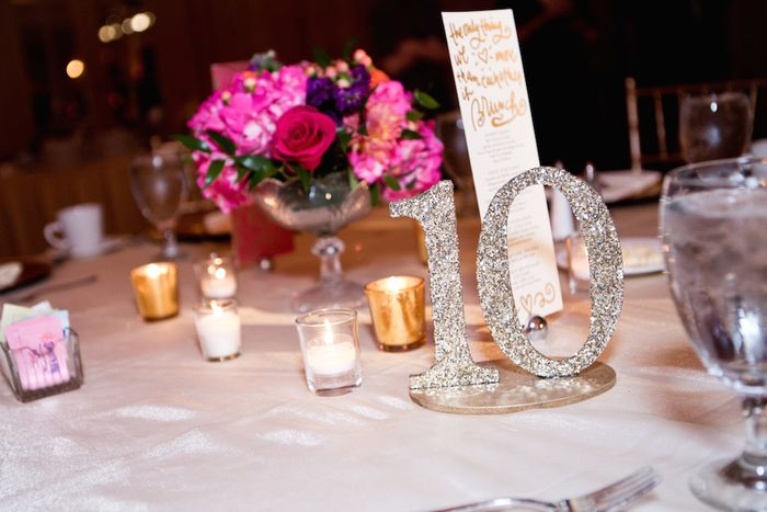 Glitter-table-numbers-and-hot-pink-centerpieces