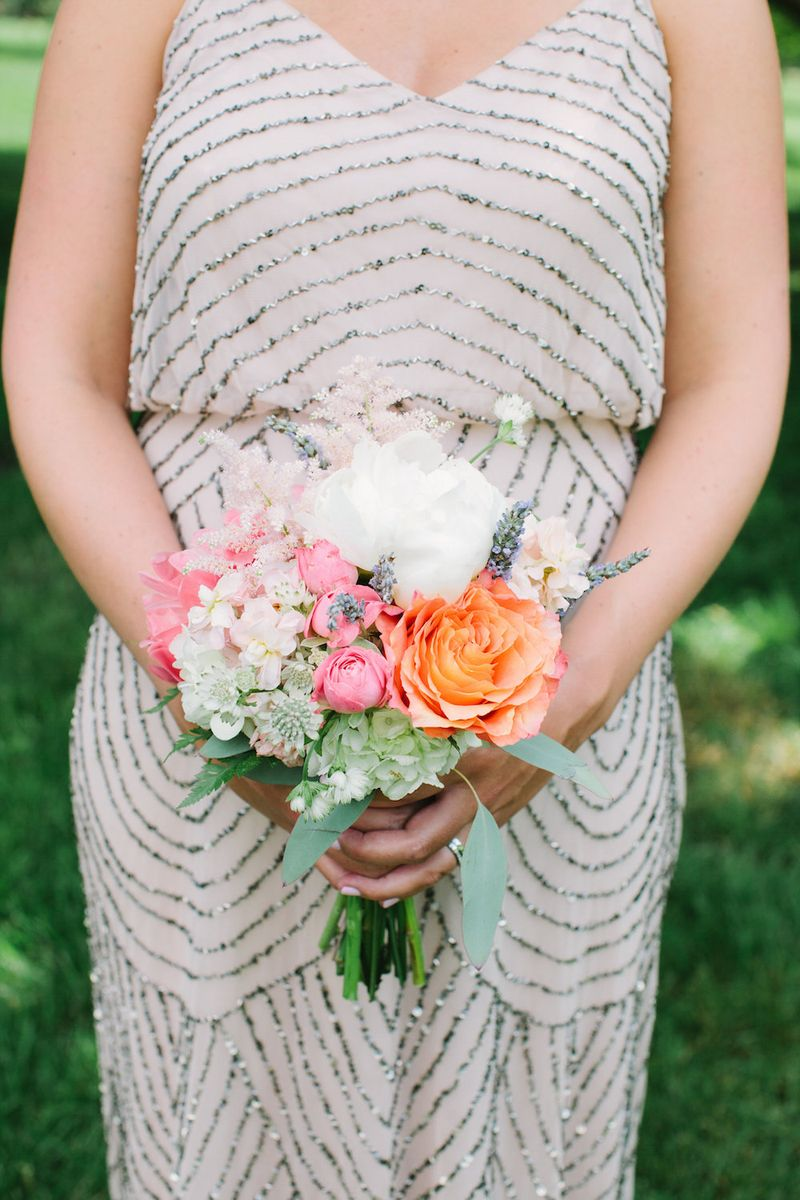 Coral orange, and ivory bridesmaids bouquet