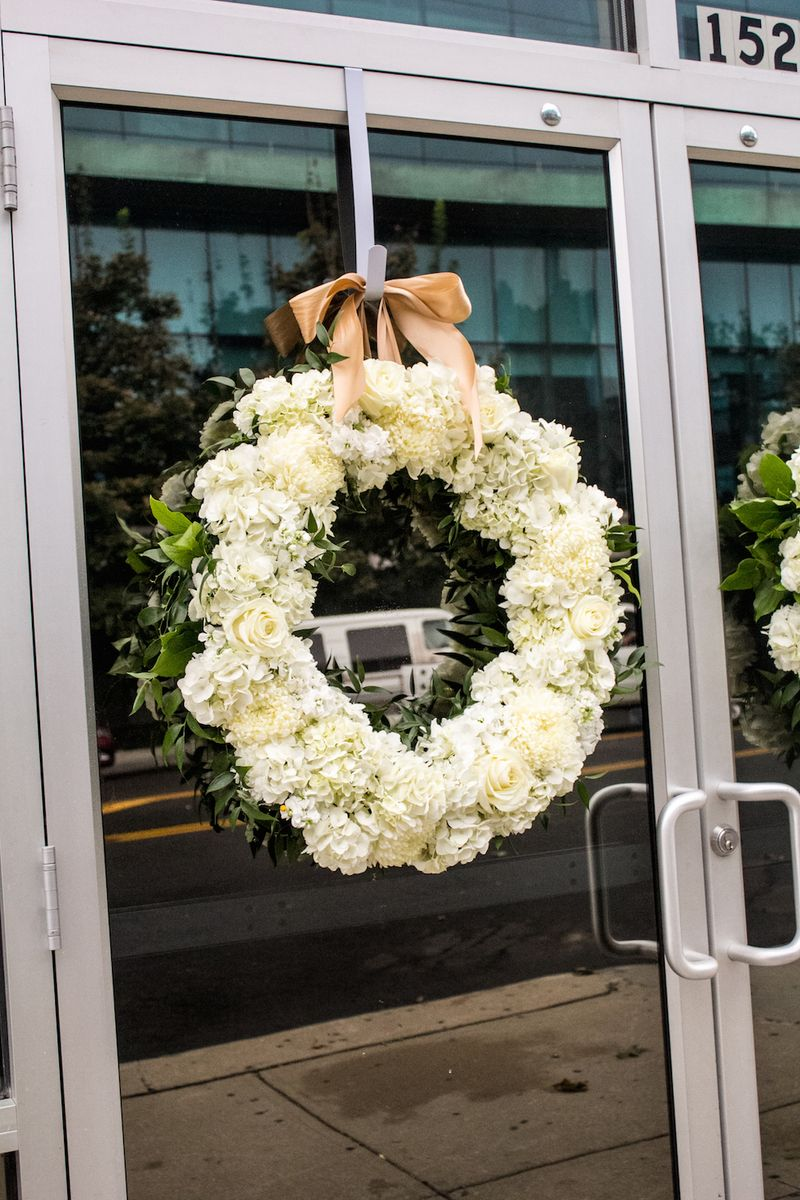 White-floral-wreaths-for-the-church-doors