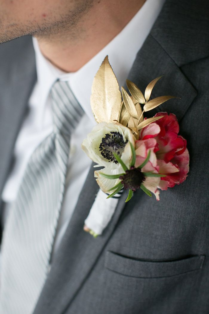 Anemone-and-gold-leaf-boutonniere